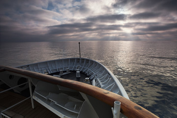 View across the ocean from the bow of a cruise ship at dawn.
