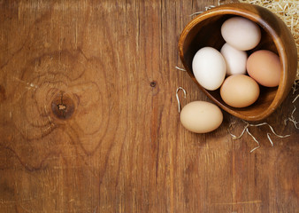 Farm natural organic eggs on a wooden background