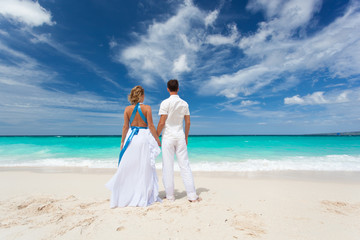 Loving wedding couple on beach