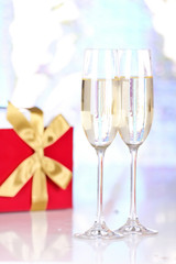 Pair glasses of champagne and present box