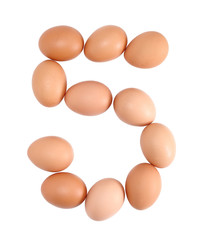 Number five made of Eggs. Isolated on white.