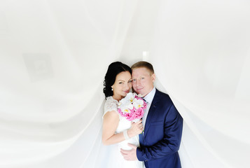 the bride and groom on a white background. the bride with a wedd