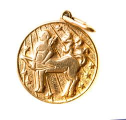gold pendant isolated on white background. Sagittarius