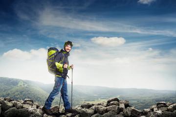hiker in full equipment walking