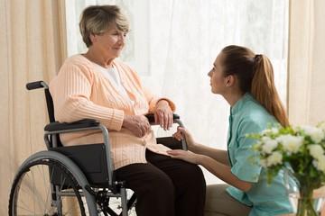 Caregiver helping old female