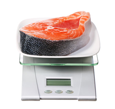 food scale with salmon fish electronic and digital isolated on w