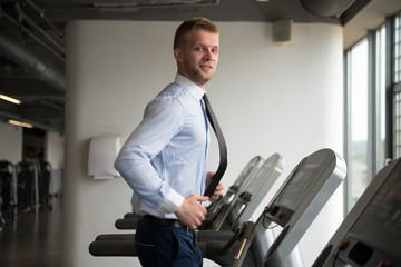 Businessman Running On Treadmill