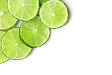 Sliced fresh limes isolated on white