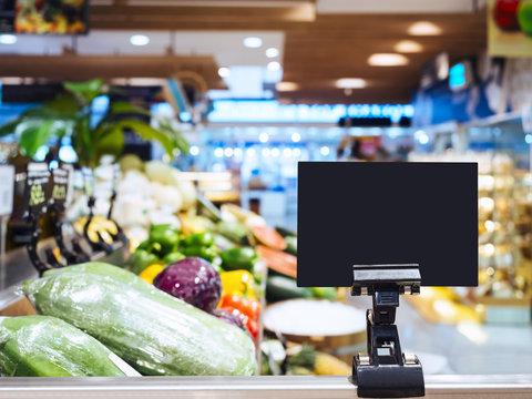 Mock up Blank sign display in supermarket Interior background Re