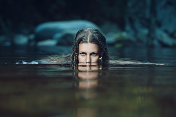Dark water nymph with intense gaze