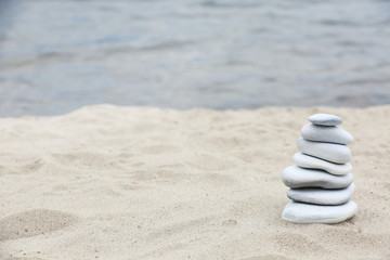 Wall Murals Stones in Sand Zen stones balance spa on beach