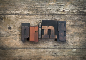 print, word written with vintage letterpress printing blocks on rustic wood background