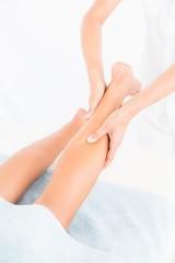 Female masseur massaging womans leg