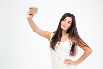 Smiling young woman making selfie photo