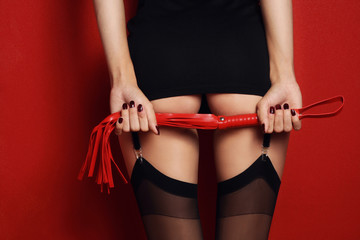 Sexy woman ass with red whip.