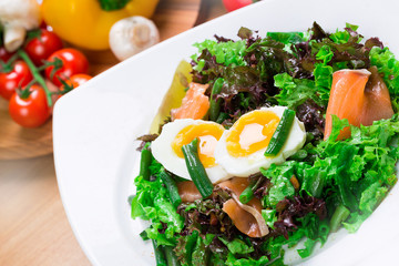 Fresh green salad with salmon and eggs