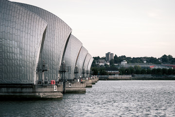 Thames Flood Barrier, London. A view along the Thames flood barrier which runs across the river in East London.