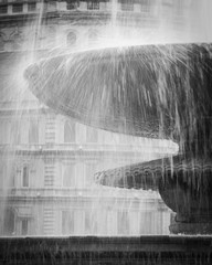 London fountain. Detail of water falling from one of the large fountains found in London's Trafalgar Square.