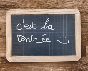 Back to school in french on black slate