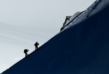 Mountaineers climbing in snow