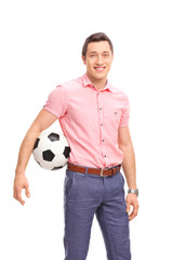 Young casual guy holding a football