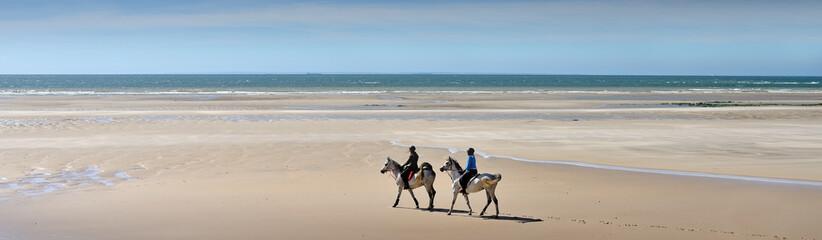Papiers peints Equitation soirée à cheval sur la plage