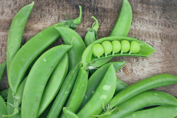 Fresh green soybeans on a wooden vintage