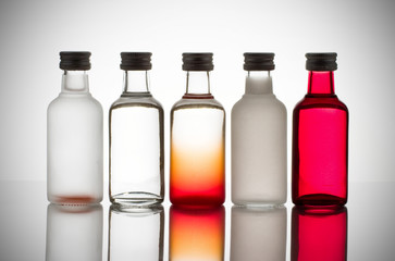 Back lit collection of colorful glass bottles