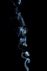 Delicate and bright smoke waves on dark background
