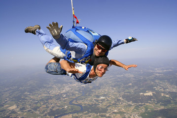 Skydiving tandem father and son