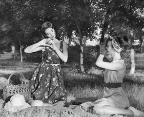 Girls make pictures at a picnic retro