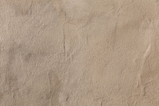 Beige stucco wall. Background texture