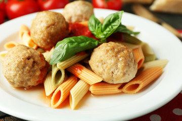 Pasta with meatballs on plate, on wooden  table background