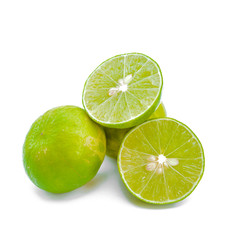 Juicy slices of lime isolated on white background.