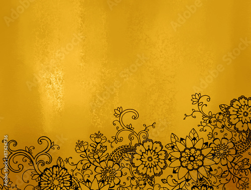 abstract gold background with hand drawn black abstract flowers and