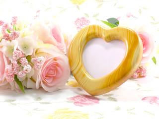 blank heart frame and rose flower