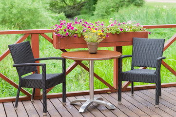 Outdoor terrace cafe table with two chairs