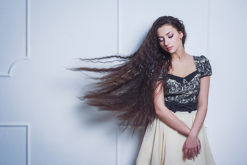 Pretty young woman with closed eyes and long hair