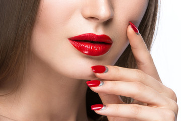 Beautiful young girl with a bright make-up and red nails. Beauty