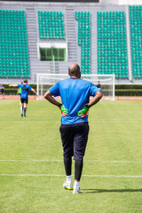 Goal keeper waiting , back view