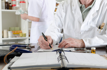 Doctor holding taking notes