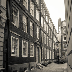 Hare Court, Temple, London. A retro styled sepia image of one of the small pedestrian streets that still display signs of Victorian London in the Temple area.
