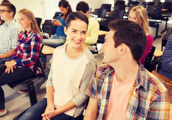 group of smiling students in lecture hall