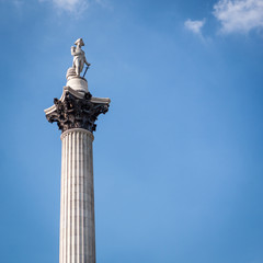 Nelson's Column, London. Low angle view of the London landmark Nelson's Column set against blue sky copy space.