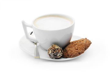 сup of coffee with chocolate candy, cookies and teaspoon