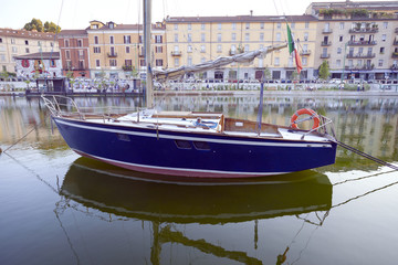 Sailboat moored on Darsena, Milan city. Color image
