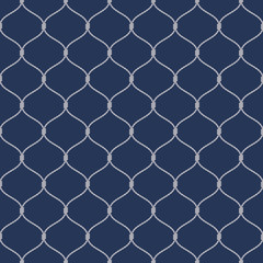 Nautical rope seamless fishnet pattern on dark blue background