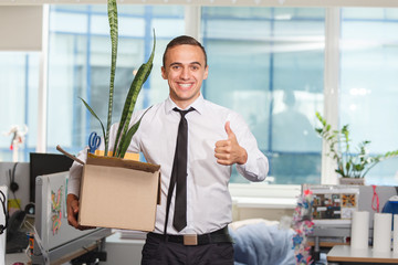Happy just fired an office worker with personal items in a box