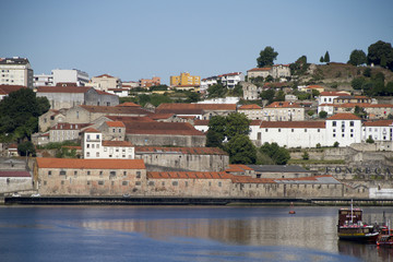 Old warehouses for storage and aging of port wine line the Duoro River.Oporto,Portugal