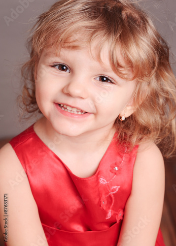 33d1668b8b3d Close up portrait of smiling cute little girl on gray. Sweet baby ...